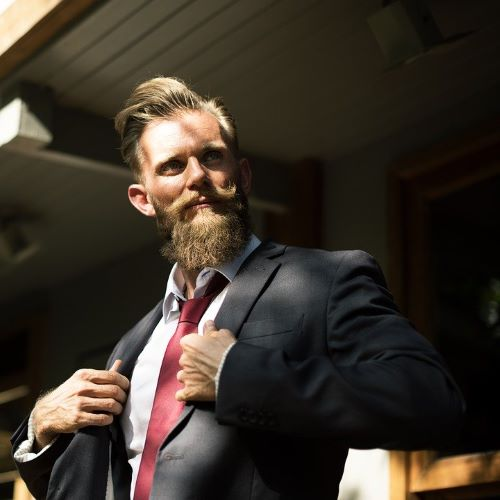 A suited man with a beard